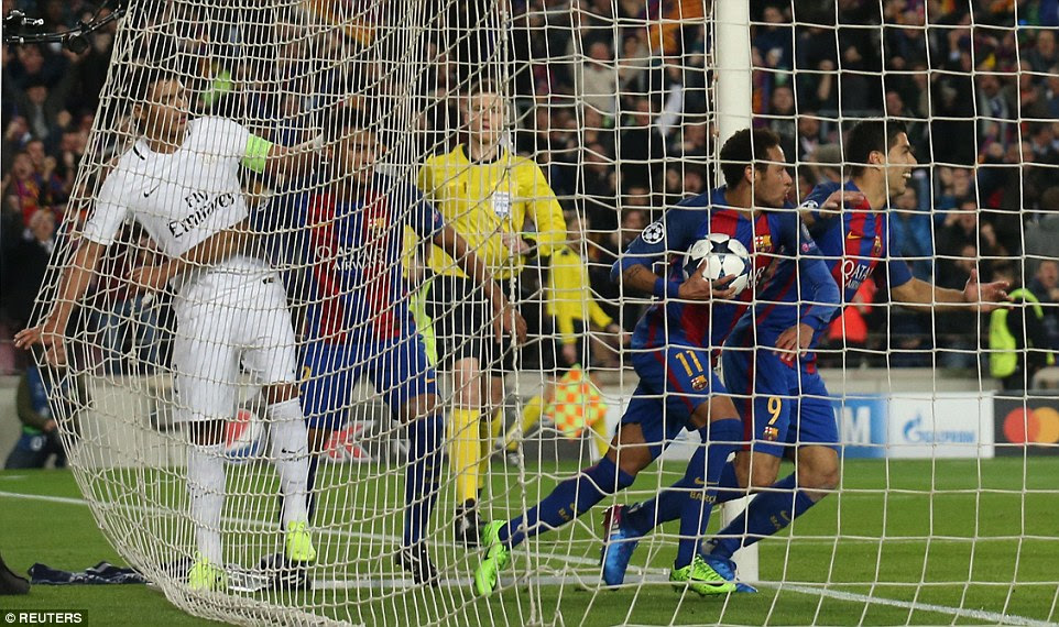 Three Barcelona players including Rafinha, Neymar and Luis Suarez gather the ball out of the net after the second goal