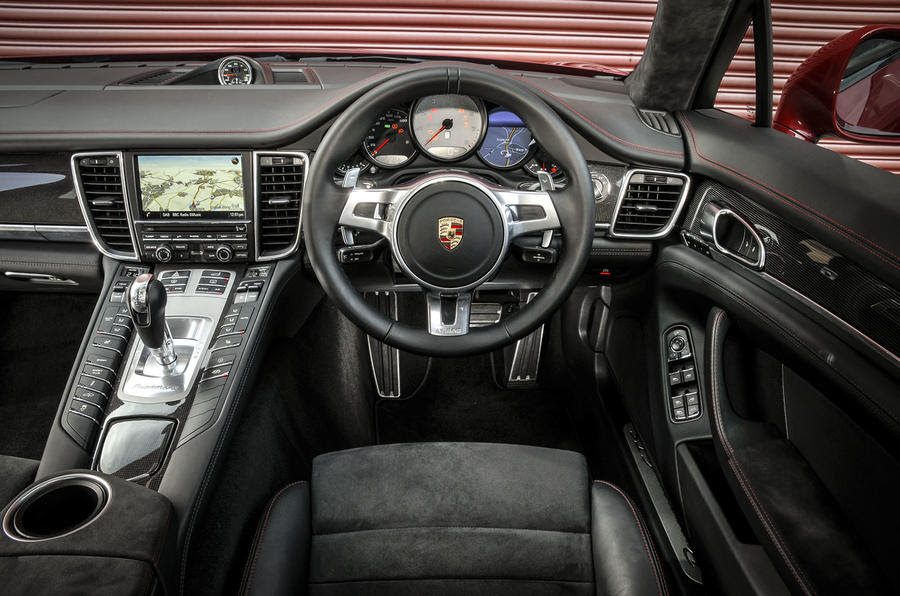 The cabin of the Panamera is typically luxurious, but its infotainment ...