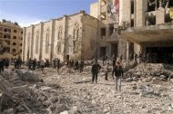 Syrian security inspect the site of an explosion in Syria's northern city of Aleppo February 10, 2012. REUTERS/SANA