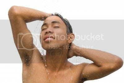 photo 5526228-portrait-of-young-asian-male-intensely-enjoying-a-shower-and-running-water-with-eyes-closed-and-arms_zps475729af.jpg