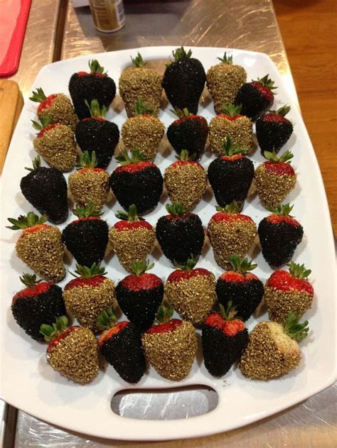 Chocolate dipped strawberries with black and gold