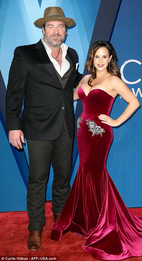 Couples night! Eric Paslay cosied up to his wife Natalie Harker, while Lee Brice was joined by his wife,Sara Reeveley