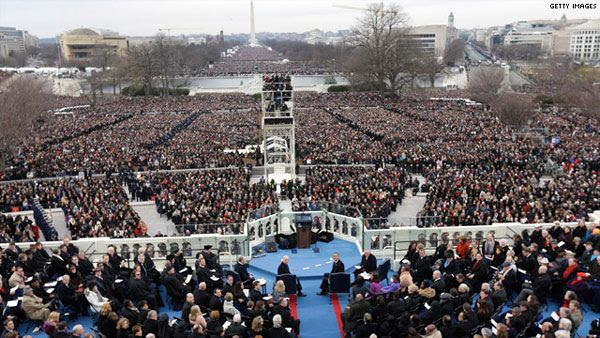 Hundreds of thousands of people gather at Capitol Hill to watch the Presidential Inauguration take place on January 21, 2013.