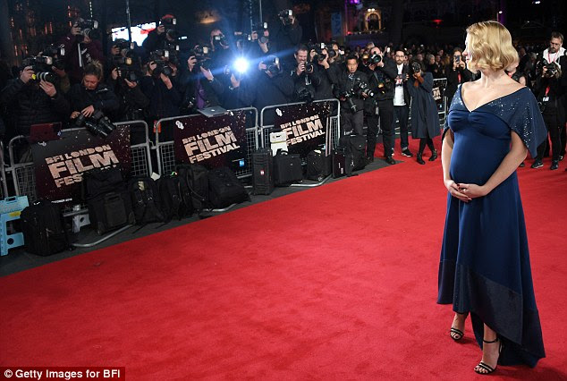 Working it: The blonde beauty showed off her baby bump from all angles