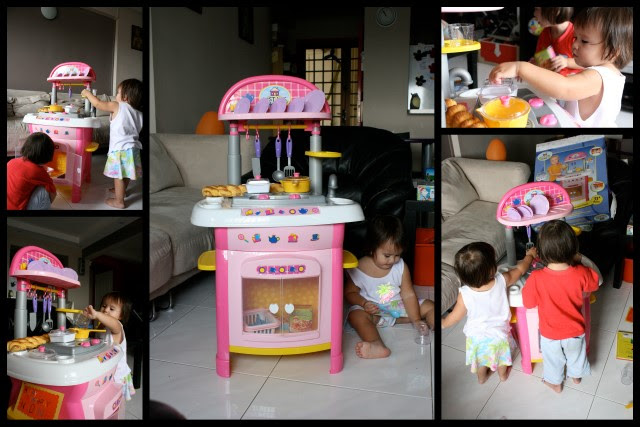 They both love the gorgeous kitchen set - it's got light and sounds!