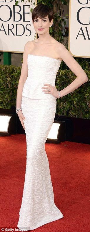 Anne Hathaway in a spangled, strapless Chanel Haute Couture two-piece was as colourless as porridge