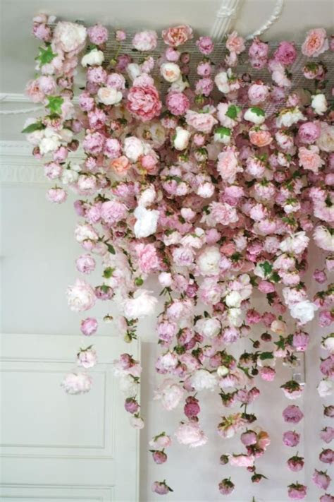 Backdrop of Flowers hang from the ceiling   Event