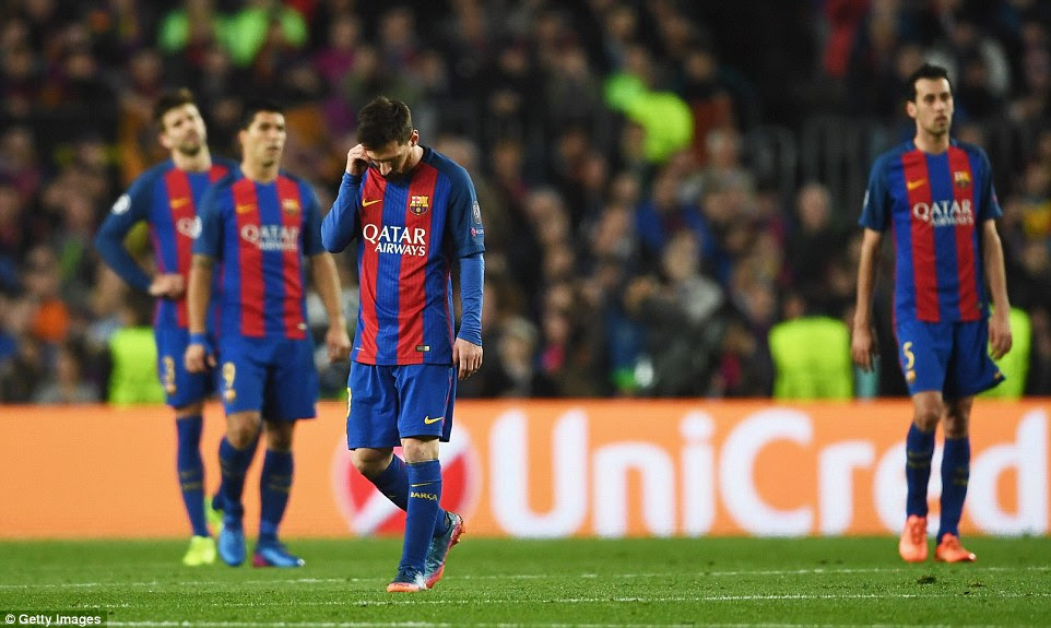 Lionel Messi and his team-mates look dejected after Cavani's goal meant they needed to score three more to qualify