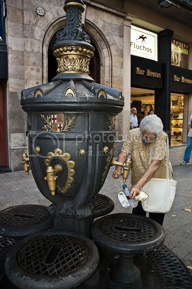 Old Lady and Fountain, Portal de L'Angel, Barcelona [enlarge]