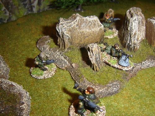 Team 1 moves through rough ground