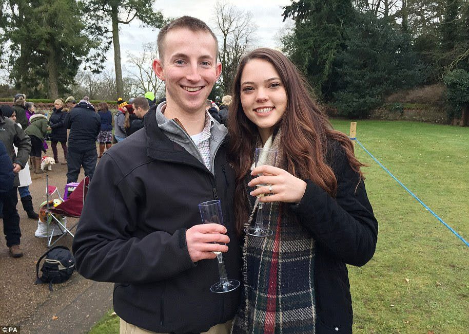 American couple Mike Metz and Ashley Millican, both aged 20, were waiting to see the Queen, Prince Harry and his fiancee attend St Mary Magdalene Church on the Queen's Sandringham Estate for the Christmas Day service when Mike got on one knee