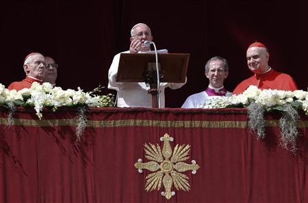 Pope Francis speaks during his ''Urbi et Orbi'' (To the City and the World) address from a balcony in St. Peter's Square at the Vatican March 31, 2013. REUTERS/Stefano Rellandini