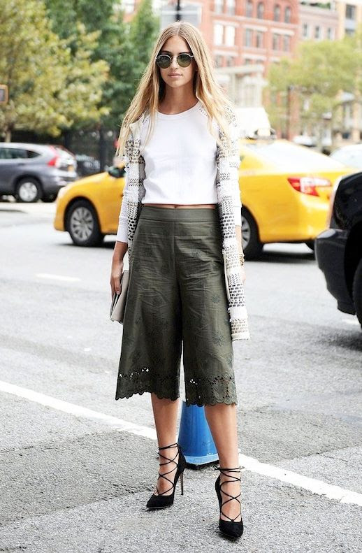 Le Fashion Blog Street Style Date Look Officewear Trends Round Sunglasses White Crop Top Long Printed Cardigan Olive Green Culottes With Embroidered Details Black Lace Up Pumps Via Popsugar