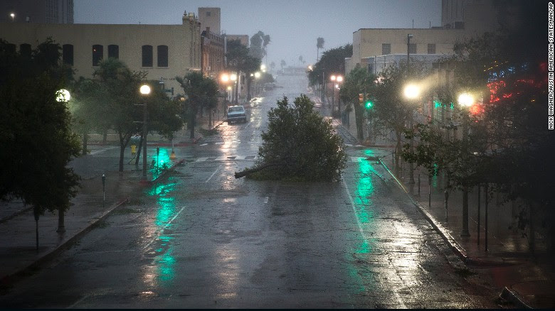 A tree blocks a street as Hurricane Harvey makes landfall in Corpus Christi, Texas on Friday.