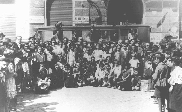 Jewish children leaving for a summer camp organized by the Yiddisher Shul Verein (Yiddish school association). Chernovtsy, Romania, ca. July 1933.