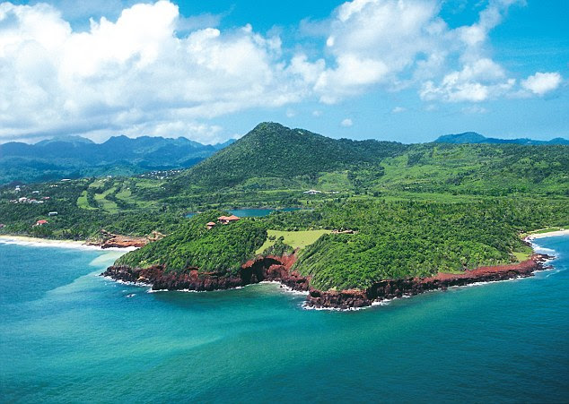 Named Kick 'em Jenny, the volcano - which sits 180m below sea level off the northern coast of Grenada (pictured) - has produced no less than 200 small earthquakes since it began stirring on July 11