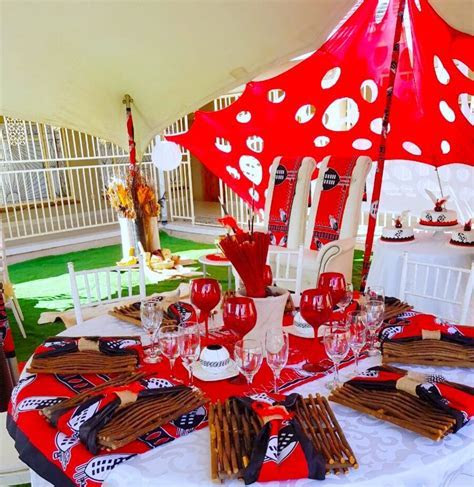 Black, red and white Swazi traditional wedding decor by