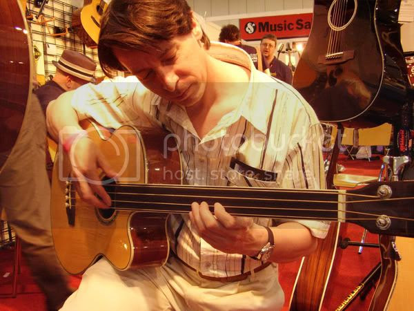 Paul plays the Ashbury acoustic fretless bass