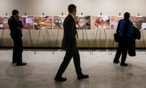 Visitors look at the controversial photographs of dead bodies at the United Nations Headquarters in New York.