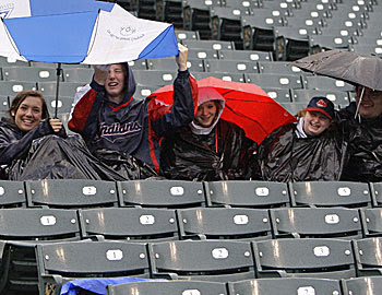 Fans have already soaked up 29 weather-related postponements, eight more than all of last season. (AP)