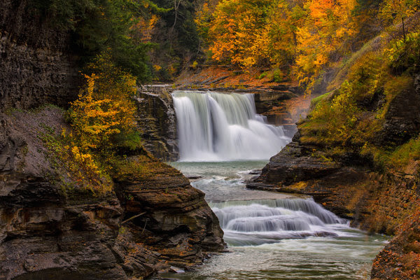 "For this image of Lower Falls in Letchworth State Park in New York, I knew I wanted a creamy look to the falls.  They were flowing well so I knew a moderately slow shutter speed would give me what I wanted.  I also knew as I composed it that I wanted the falls framed by some of the gorgeous colors of the fall foliage.  I set my exposure based on two things- I wanted a slow shutter speed and I wanted deep depth of field. EOS 5D Mark III, EF 70-300 f/4-5.6L, ISO 100, f/25, .3""."