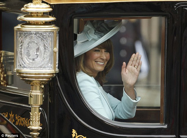 Mother of the bride: Carole Middleton, mother of Catherine, Duchess of Cambridge, waves as she travels with Britain's Prince Charles and Camilla to Buckingham Palace after the wedding
