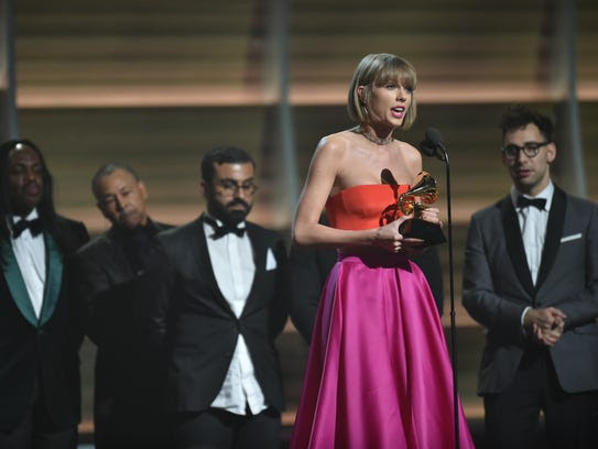 Taylor Swift accepts Album of the Year for 1989 during