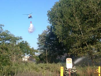 NYPD helicopter dropping on brush fire