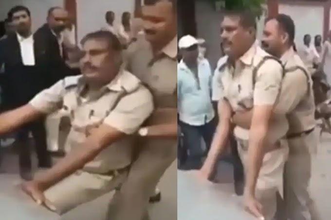 पुलिसवाला बीच सड़क कार के सामने करने लगा ऐसी हरकत, Video हुआ वायरल