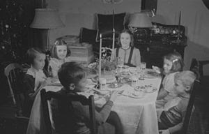 A group of children at Christmas dinner.