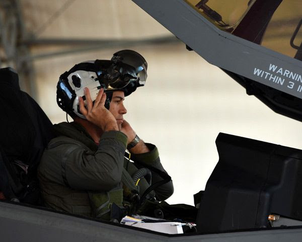 U.S. Navy Lt. Cmdr. Charles Escher prepares to fly a sortie aboard a U.S. Air Force F-35A Lightning II...from Eglin Air Force Base in Florida on December 6, 2016.