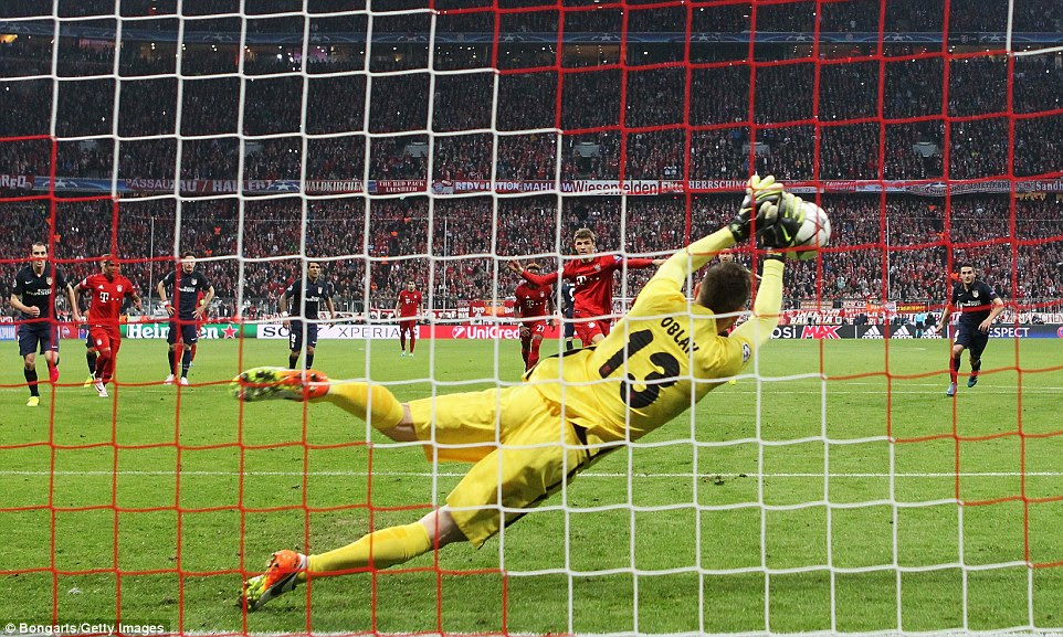 Thomas Muller saw his penalty saved by Jan Oblak in the first half after Gimenez was penalised for fouling Javi Martinez
