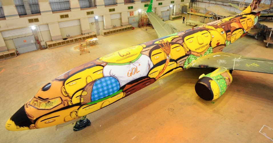 Os Gemeos Paints a Mural on a Boeing 737 with 1,200 Cans of Spray Paint for Brazils World Cup Team World Cup street art sports murals Brazil airplanes