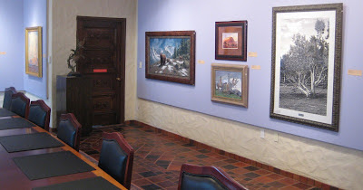 Photo of one of the display rooms at the Springville Museum of Art with painting by Roland Lee
