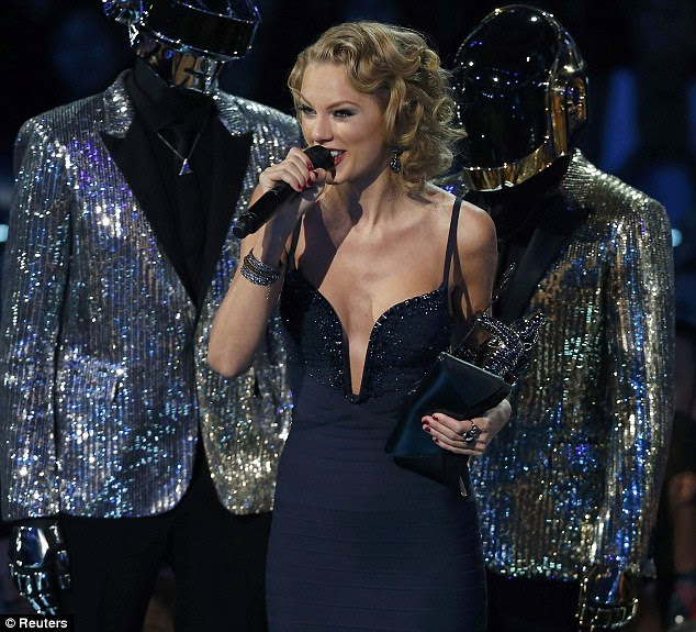 Making a pop: Taylor Swift thanked an ex-boyfriend for inspiring her as she accept an award at the MTV VMAs on Sunday