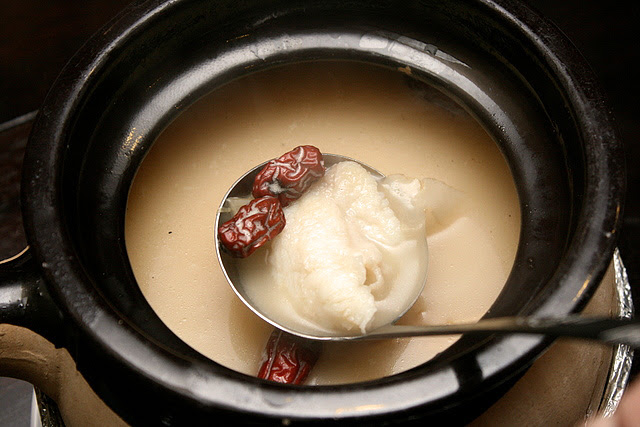 "Giant Garoupa ""Photophores"" soup - a rich, milky broth that's made from boiled bones and scales"