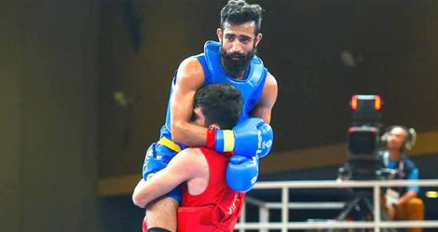 21 YO old Erfan Ahangaria showing the sportsmanship at the Asian Games is winning hearts