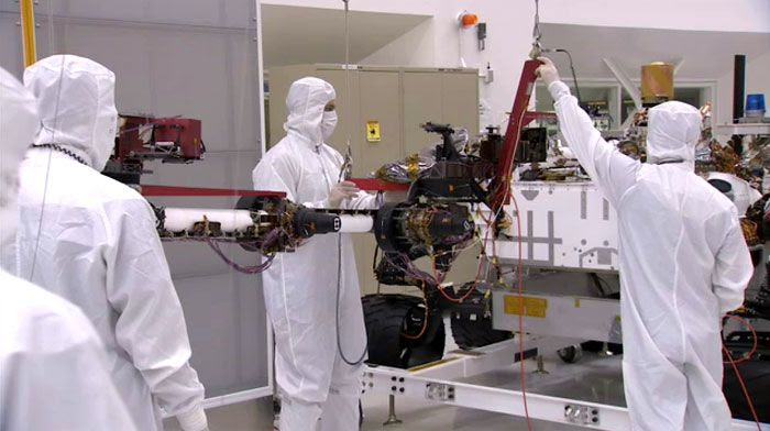 Engineers are about to install a robotic arm onto the CURIOSITY Mars Rover at NASA's Jet Propulsion Laboratory in Pasadena, California.