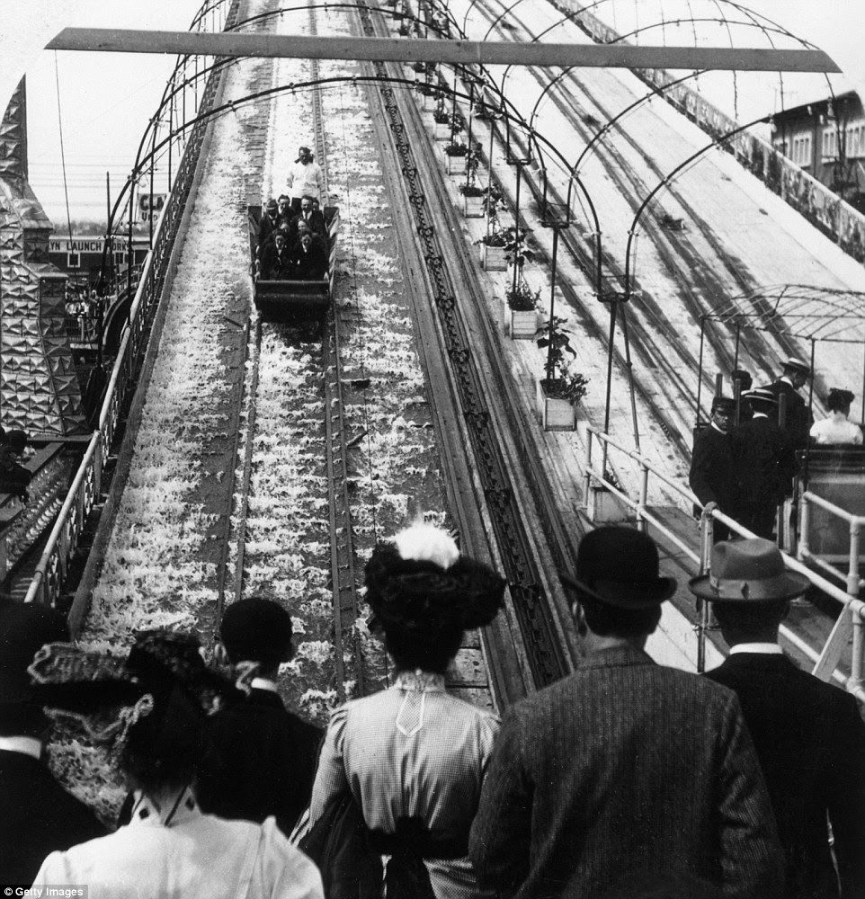 Taking the plunge: Spectators watch a car plunge down the track on the 'Shooting the Chutes' ride at Luna Park in 1903