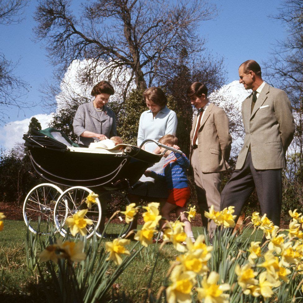 Queen Elizabeth II, baby Prince Edward, Princess Anne, Prince Andrew, Prince Charles and the Duke of Edinburgh, in the gardens of Frogmore House, Windsor, Berkshire