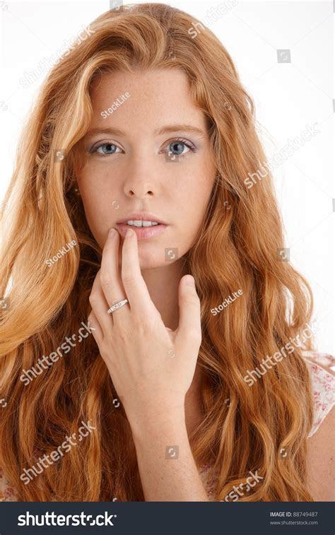 pretty redhead portrait closeup face hand stock photo