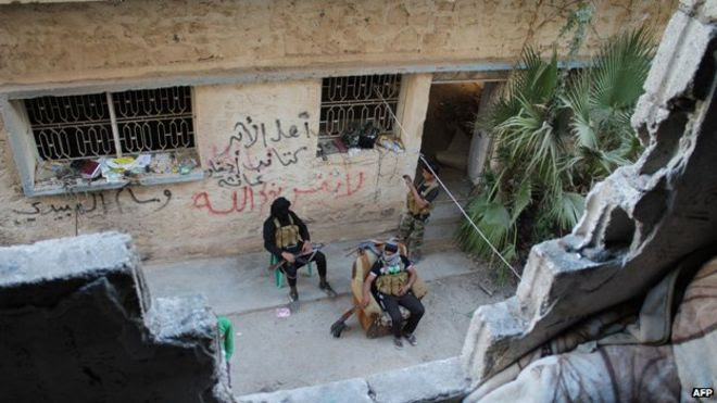 Opposition fighters in the city of Deir Ezzor