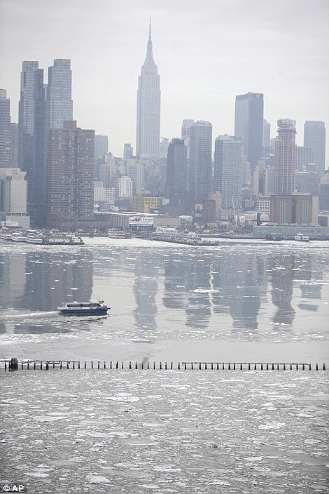A New York Waterway ferry chugs along the Hudson River, where floating ice is seen on a mild winter day, Thursday, Jan. 11, 2018, in Weehawken, N.J. (AP Photo/Julio Cortez)