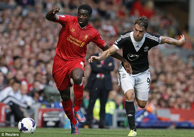 Tussle: Kolo Toure and James Rodriguez battle for possession