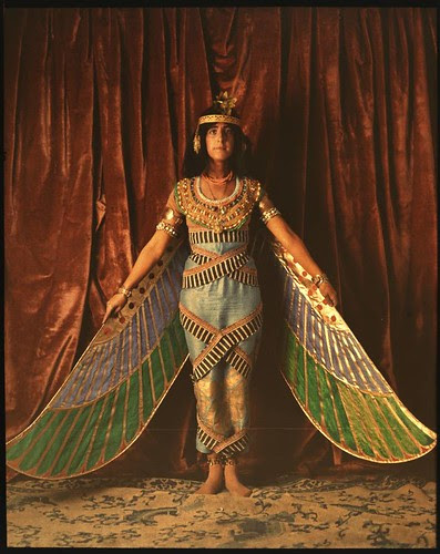 Dancer wearing Egyptian-look costume with wings reaching to the floor
