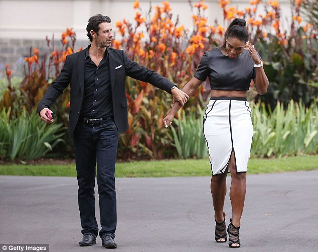 Mouratoglou (left) arrives at a photocall with Williams after her Australian Open triumph in Melbourne this year