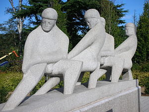 Teamwork, a large monoilithic granite sculptur...
