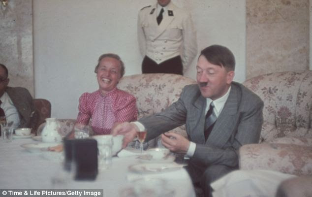 Leisure: Adolf Hitler (right) eats a meal with his personal physician, Professor Theodor Morell (left), and the wife of Gauleiter Albert Forster, in rare photos also due to go under the hammer
