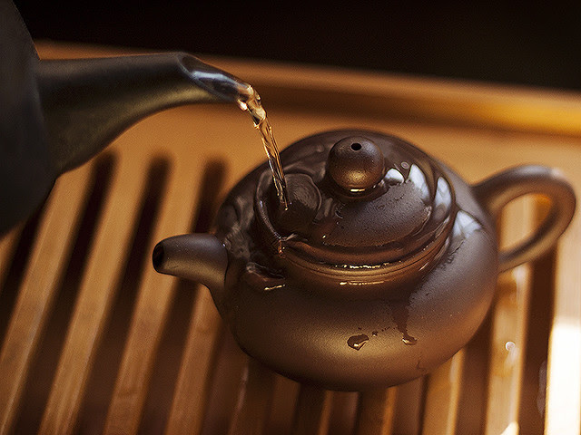 warming the teapot.