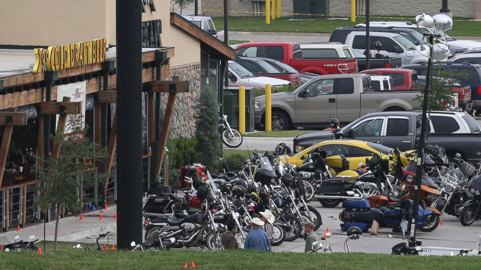 PHOTO: Law enforcement continue to investigate the motorcycle gang related shooting at the Twin Peaks restaurant, May 18, 2015, in Waco, Texas.